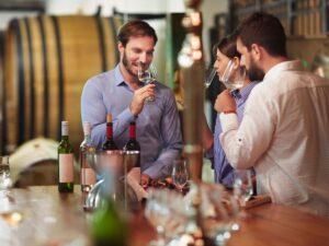 Three customers taste wine at a winery