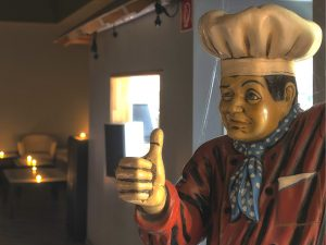 Chef statue gives thumbs up